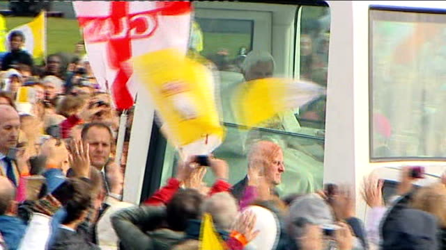 pope benedict xvi state visit: final day; pope benedict xvi along in popemobile through crowd baby handed up to pope to be blessed - ローマ法王専用車点の映像素材/bロール