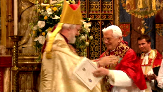 historical significance pope benedict and archbishop of canterbury embracing on altar and catholic and anglican clergy greeting each other as... - anglican stock videos & royalty-free footage