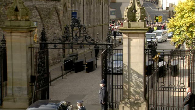 pope received by queen at holyrood house palace of holyroodhouse high angle shot of courtyard with military bands waiting / aerial convoy along /... - state visit stock videos & royalty-free footage