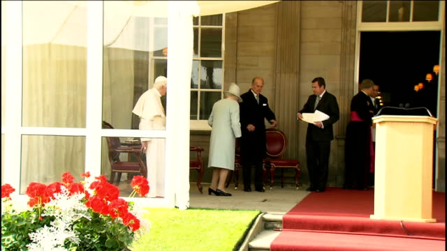 Pope speech and Queen's speech at Holyrood House Palace of Holyroodhouse EXT Alex Salmond MSP speaking with unidientified man / Queen Elizabeth II...