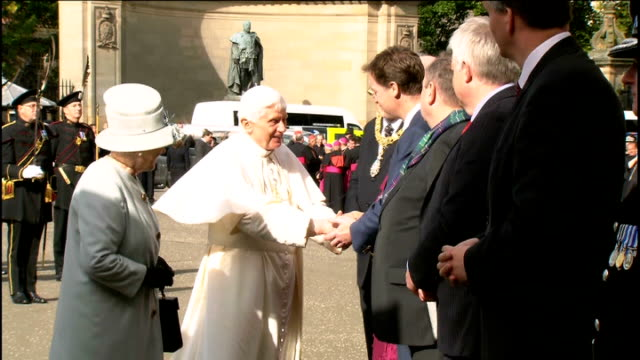 pope benedict xvi state visit; various views of the queen introducing pope to dignitaries includng the lord provost of edinburgh george grubb,... - ローマ法王専用車点の映像素材/bロール