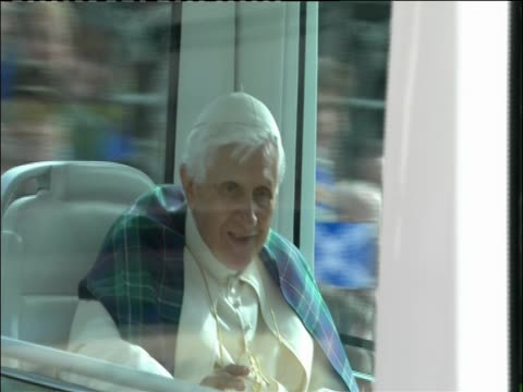 pope benedict xvi travels in pope mobile through edinburgh during papal visit - ローマ法王専用車点の映像素材/bロール