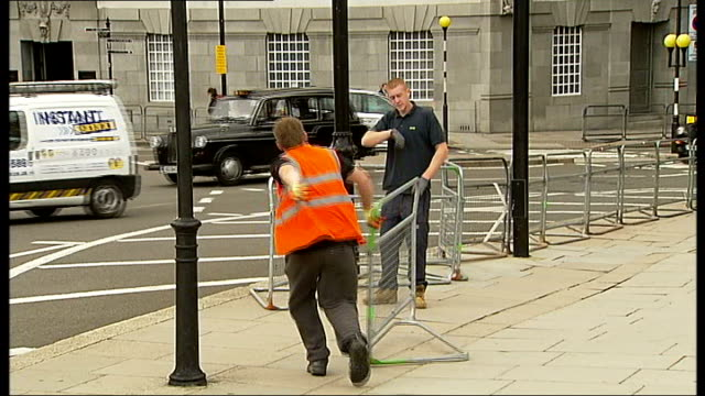 papal visit could bring chaos to london england london ext workmen unloading crowd barriers from back of flatbed lorry in preparation for the visit... - overtaking stock videos and b-roll footage
