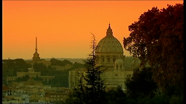 preparations amid Catholic Church child abuse controversy ITALY Rome The Vatican Wide shot city skyline showing St Peter's Basilica orange sky at...