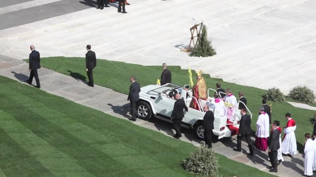 pope benedict xvi waves to the faithfuls during palm sunday mass in st peter square easter celebrations in rome on april 24 2011 in vatican city... - ceremonial robe stock videos and b-roll footage