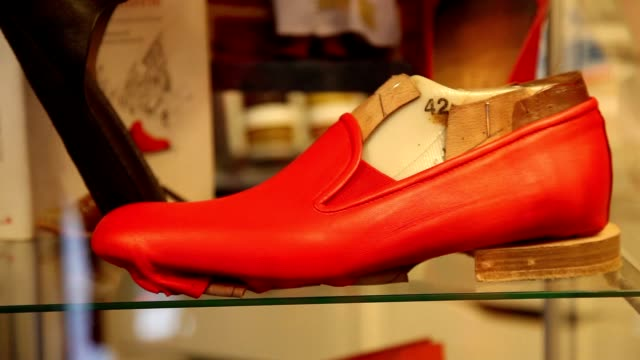 clean pope benedict xvi's shoemaker antonio arellano with the iconic red shoes of the pontiff in his shop on february 23 2013 in rome italy - ベネディクト16世の退位点の映像素材/bロール