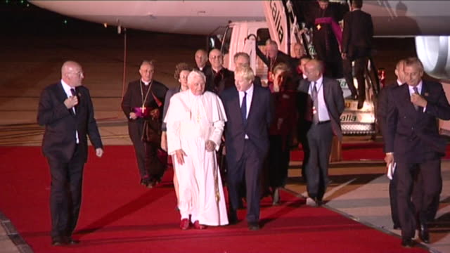 Pope Benedict XVl arrives at Heathrow for visit to Britain and walks down red carpet with London Major Boris Johnson into airport VIP suite
