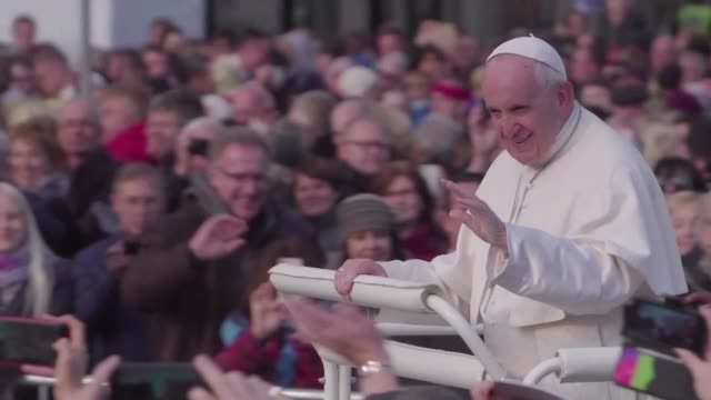 pope francis gives a mass in freedom square in tallinn at the end of a tour to the baltic states while residents of tallinn give their opinions on... - pope stock videos & royalty-free footage