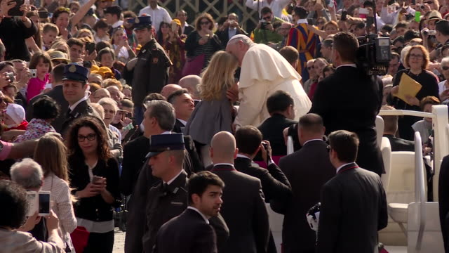 pope francis kissing a young girl on the forehead and greeting crowds gathered in the vatican - pope stock videos & royalty-free footage