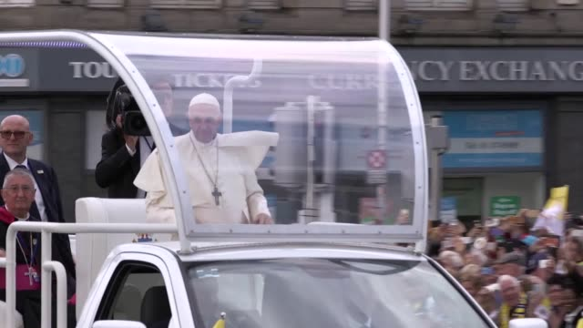 pope francis passes along o'connell bridge in dublin in his 'popemobile'. - pope stock videos & royalty-free footage