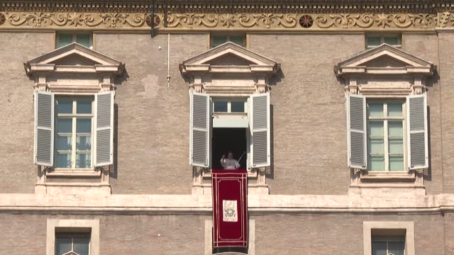 pope francis recites the angelus prayer in front of a larger audience than in recent weeks as the sun shines over saint peter's square - st peter's square stock videos & royalty-free footage