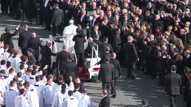 pope francis swept into a sun drenched st peters square to greet the throngs of nearly 200000 pilgrims who cheered latin americas first pontiff in st... - drenched stock videos & royalty-free footage