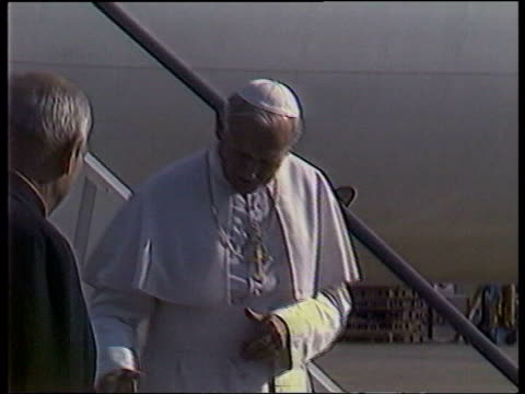pope john paul ii death: his legacy; file / may 1982 england: gatwick airport: pope down plane steps on his first visit to britain and kisses ground... - pope stock videos & royalty-free footage