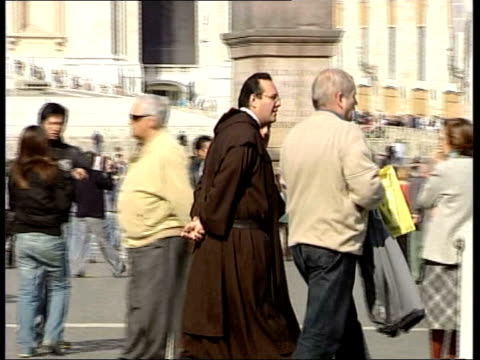 pope john paul ii dies: events; ext/day tgv many people milling about in square monk along in square gv large polish flag held up gv legs of people... - pope john paul ii stock videos & royalty-free footage