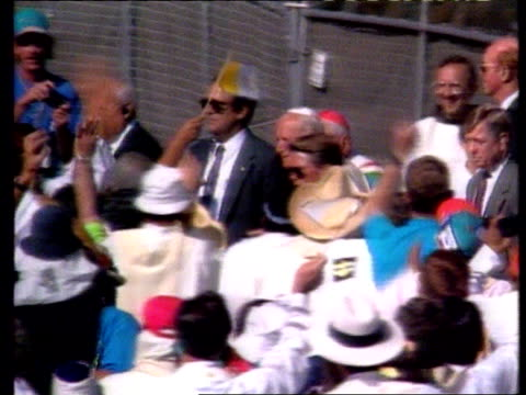 pope john paul ii hurt in fall; location unknown: tlms pope r-l as along among crowd covered stage as bv crowds in f/g waving pope - pope john paul ii stock videos & royalty-free footage