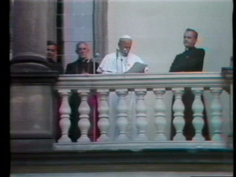 pope john paul ii reads from a balcony. - pope stock videos & royalty-free footage