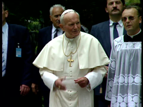 pope john paul ii walking through wooded churchyard with bodyguards and clergy poland - pope john paul ii stock videos & royalty-free footage