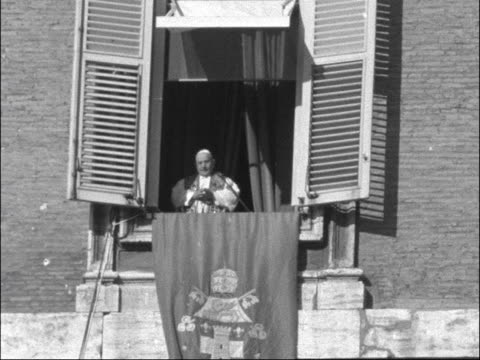 pope john xxiii blesses pilgrims in rome; italy: rome: vatican city: ext pope john xxiii at open window / crowd / man with telescope / pope at window... - pope john xxiii stock videos & royalty-free footage