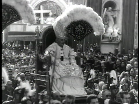 pope john xxiii blesses the crowd as he is carried on a chair. - pope john xxiii stock videos & royalty-free footage