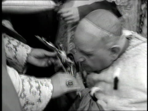 pope john xxiii kisses a crucifix. - pope john xxiii stock videos & royalty-free footage