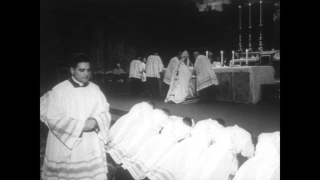 pope paul vi walks along greeting people as he makes his way to the front of the sistine chapel for a priest ordination ceremony / cu large crucifix... - priest stock videos and b-roll footage
