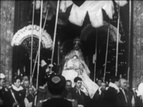 pope pius xi being carried on throne / rome / newsreel - catholicism stock videos and b-roll footage