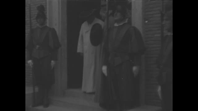 pope pius xi leaves the vatican radio station / priests and other clergy kneel one priest kisses his ring / guglielmo marconi comes out behind the... - priest stock videos and b-roll footage