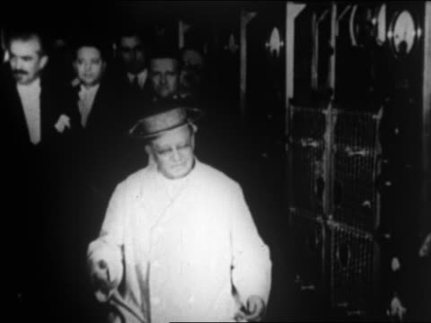 pope pius xi sitting talking / man kisses his hand / rome / newsreel - catholicism stock videos and b-roll footage