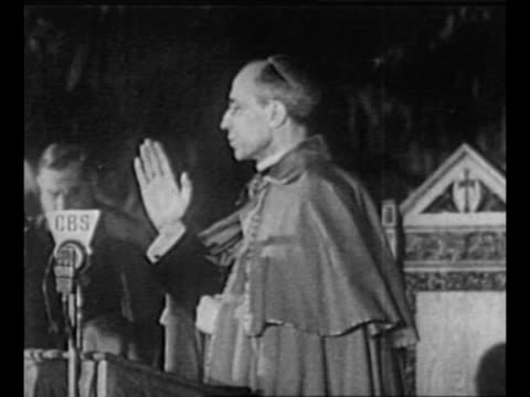 pope pius xii issues benediction, makes sign of the cross three times during his 1936 visit to fordham university in new york city; cbs microphone... - pope stock videos & royalty-free footage