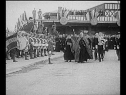 vidéos et rushes de pope pius xii seated reads from prayer book / montage cardinal eugenio pacelli arrives at lisieux station in france in 1937 / french soldiers stand... - baïonnette