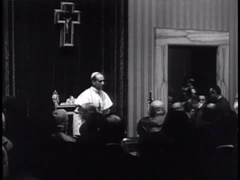 pope pius xii walking into room sitting in gilded chair speaking to people in small room gesturing w/ hand lifting replacing hat - gilded stock videos & royalty-free footage