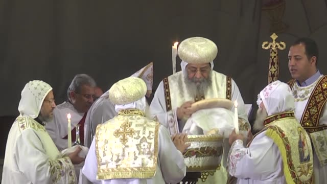 pope tawadros ii of alexandria leads a mass prayer at saint mark's coptic orthodox cathedral in cairo's al-abbassiya district on february 17, 2015 to... - isis beheading stock-videos und b-roll-filmmaterial