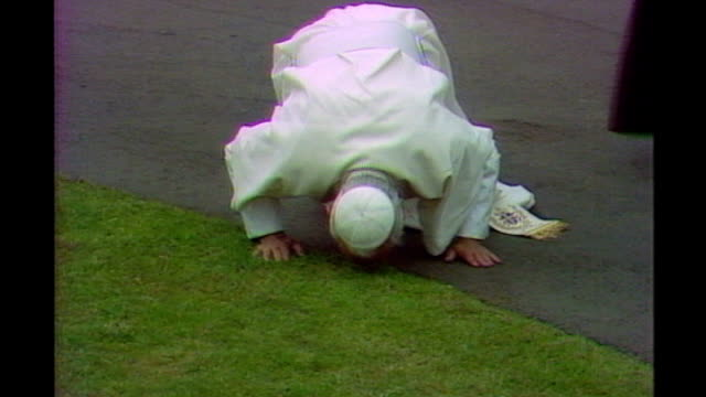 pope's visit to uk will cost taxpayers up to 12 million pounds lib / tx edinburgh ext pope john paul ii kissing ground on arrival murrayfield pope... - pope john paul ii stock videos and b-roll footage