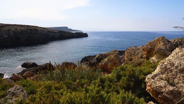 stockvideo's en b-roll-footage met popeye cliffs in the sunny day, malta - sunny