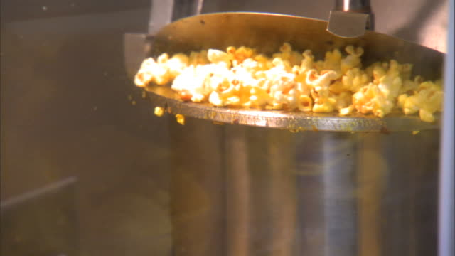 popped popcorn falling from metal kettle of machine. popper, food, popping, appliance, equipment, service, vendor, vending, snack, butter, unhealthy,... - popcorn stock videos & royalty-free footage