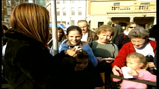 stockvideo's en b-roll-footage met poppy appeal launched by hear'say itn london myleene klass signing autograph for young fan ms suzanne shaw signing autographs cbv myleene klass... - 2001