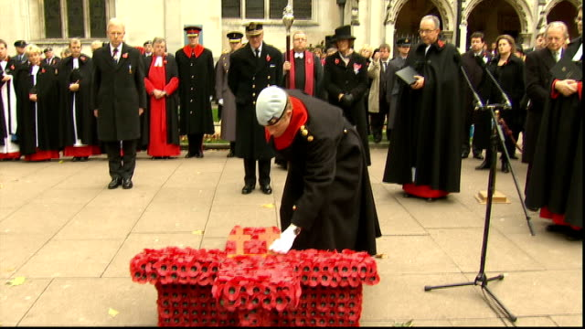 poppy day appeal duke and duchess of cambridge join appeal england london westminster abbey ext variuos of prince harry and prince philip duke of... - retail occupation stock videos and b-roll footage