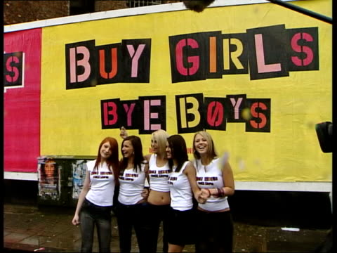 fix allegations; itn england: london ext members of popstars - the rivals girls band 'girls aloud' posing in front of poster band posing for photocall - poster stock videos & royalty-free footage