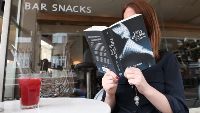 popular novel 'fifty shades of grey' has sold around 20 million copies worldwide making it the fastest-selling paperback of all time at 50 shades of... - libro in brossura video stock e b–roll