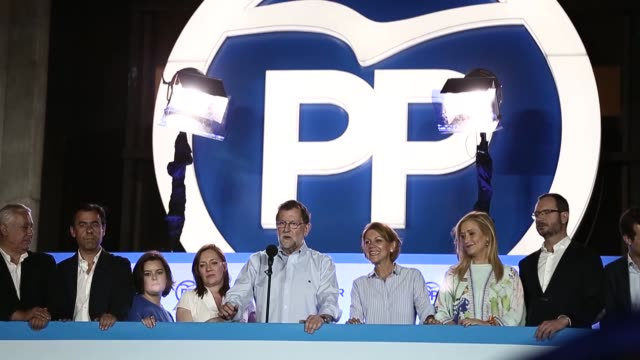 Popular Party supportes celebrate with their leader and acting Prime Minister Mariano Rajoy after coming first in the Spanish general election on...
