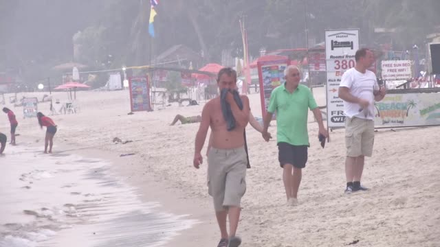 Popular Thai holiday islands are engulfed with haze from Indonesian forest fires forcing several planes packed with beach bound tourists to turn back...