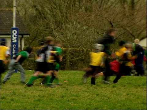 popularity rises following world cup win; itn england: devon: ext gv young boys playing rugby match geoff griveson interview sot - everyone's... - dulwich stock videos & royalty-free footage