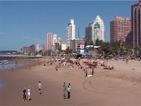 vídeos y material grabado en eventos de stock de populated beach demonstrating the strain commercialisation puts on the environment, was - elmina