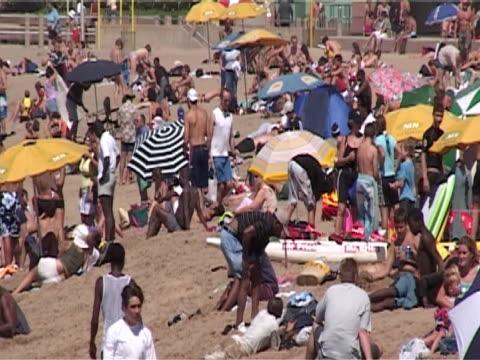 vídeos y material grabado en eventos de stock de populated beach, demonstrating the strain commercialisation puts on the environment ms - elmina