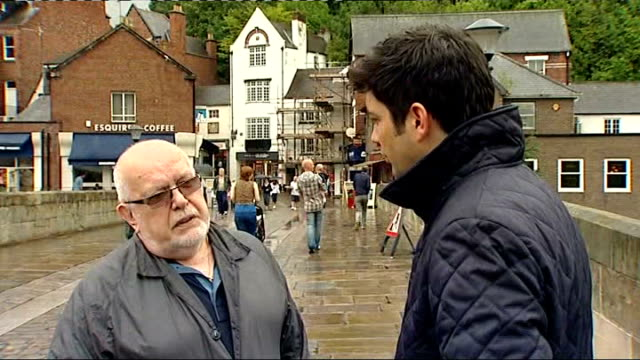 stockvideo's en b-roll-footage met report predicts rise in number of 100 year olds county durham durham pedestrians along paved shopping street in rain some with umbrellas durham... - durham engeland