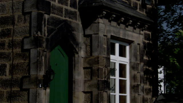 a porch light is affixed next to a green door. available in hd. - leeds stock videos & royalty-free footage