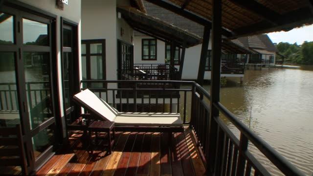 ms porch of tropical resort villa near river / sihanoukville, cambodia - cambodia stock videos & royalty-free footage