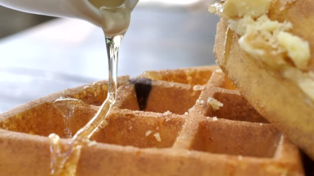 poring honey on waffles - sweet food stock videos & royalty-free footage
