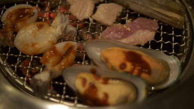 Pork and seafood barbecue grill