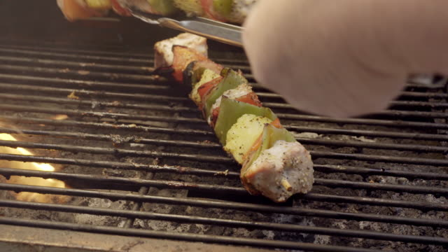 Pork Chicken Shish Kebabs on a Fiery Grill with Peppers and Pineapple